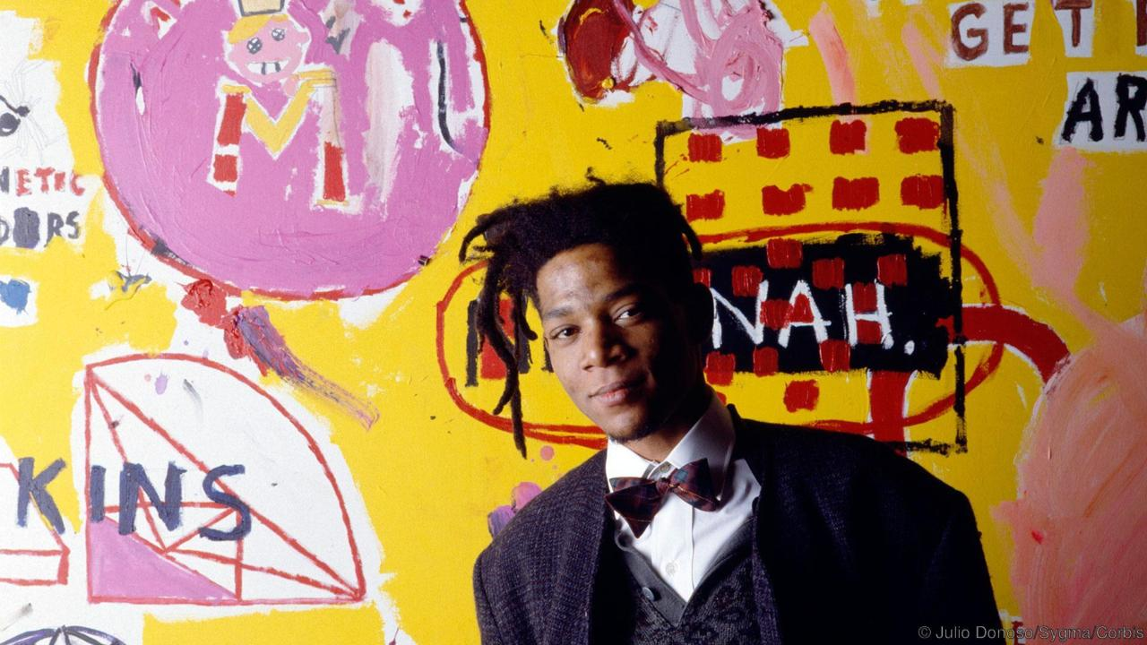 11 Jan 1988, Paris, France --- American artist, musician and producer of Haitian and Puerto Rican origins Jean-Michel Basquiat, in front of one of his paintings, during an exhibition at the Yvon Lambert gallery. --- Image by © Julio Donoso/Sygma/Corbis