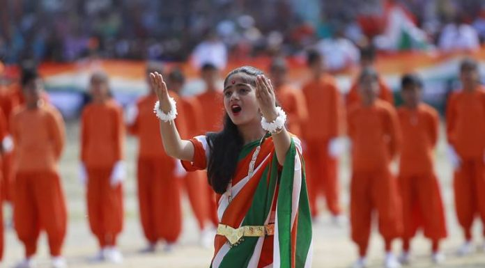 Indian students perform a dance during India's Independence Day celebrations, in Jammu, India, Wednesday, Aug.15, 2018. India won independence from British colonialists in 1947.(AP Photo/Channi Anand)
